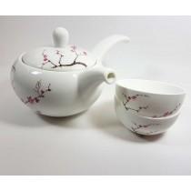 Juego de cuatro piezas fabricadas en porcelana Fina Bone, tetera, tapa y dos cuencos decorados con diseño de cerezo Japones cono